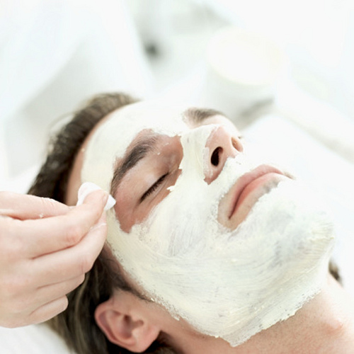 Photo of a man getting a facial