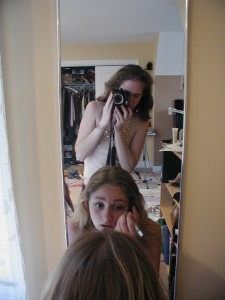 girl taking picture in the mirror