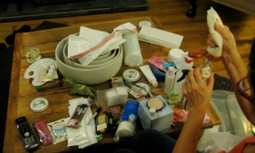 Photo of Virginia assembling her kit for State Board Esthetics Licensing Exam